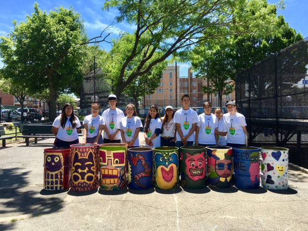 William Bryant Highschool students paint garbage cans